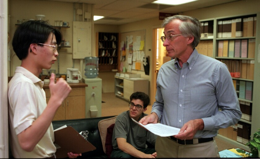 Caltech physics professor Tom Tombrello, right, speaks with a student in his Physics 11 class in 1994. Tombrello taught at the school for more than 50 years.