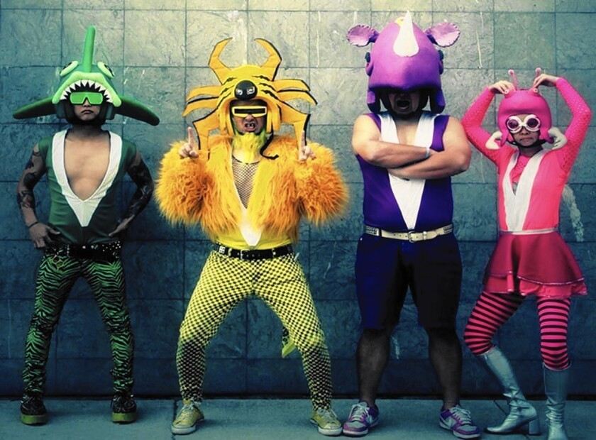 The Japanese indie punk band Peelander-Z accessorizes with color-coordinated Spandex.