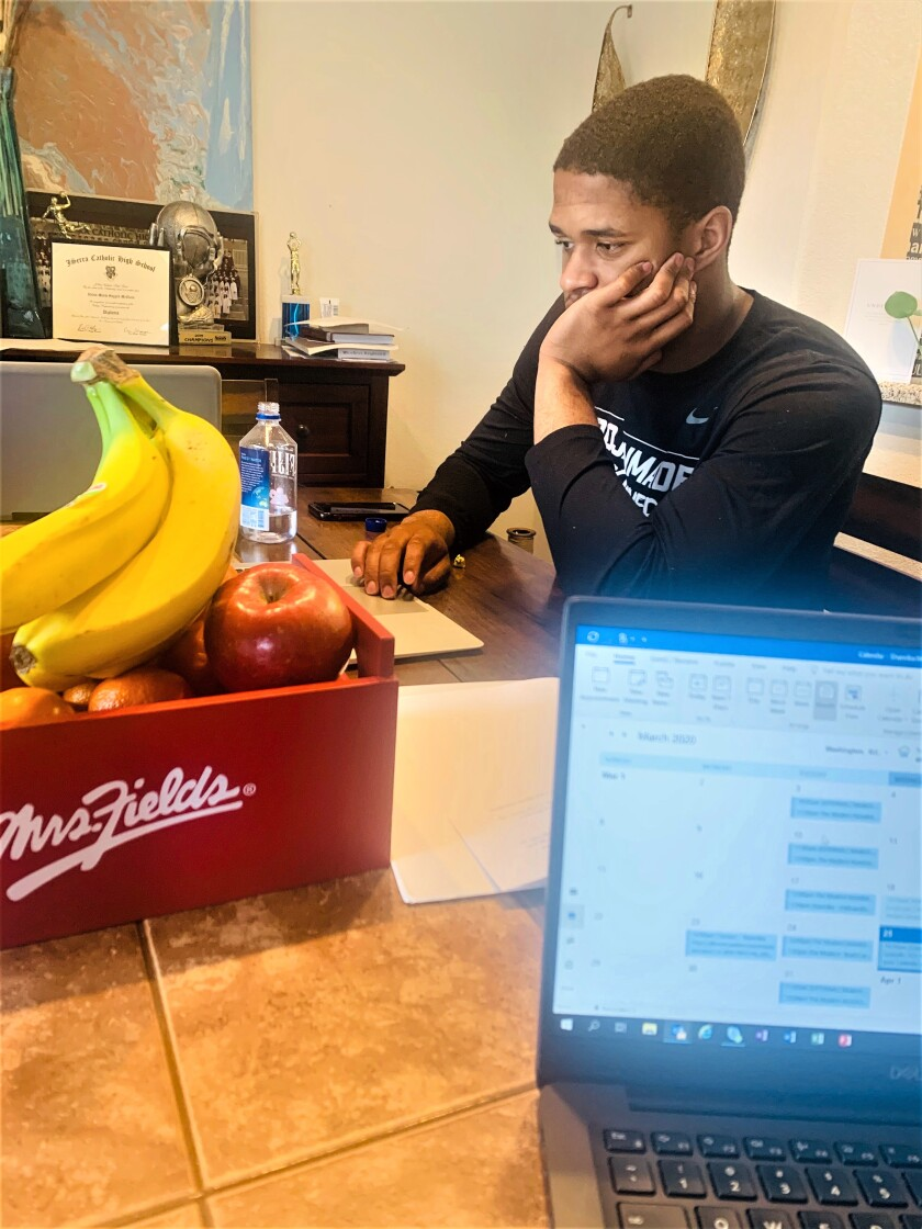 USC wide receiver Munir McClain studying at home.