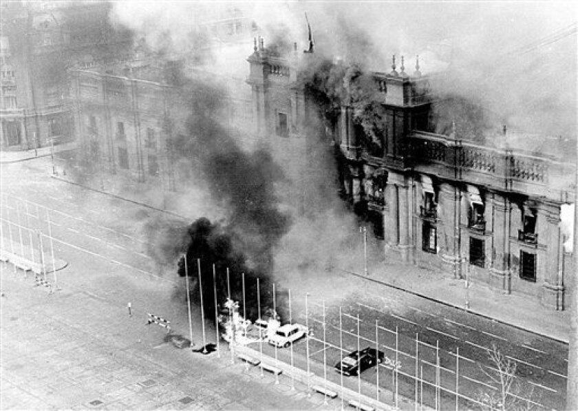 FILE - In this Sept. 11, 1973 file photo, smoke rises from La Moneda presidential palace after being bombed during a military coup led by Gen. Augusto Pinochet that overthrew President Salvador Allende in Santiago, Chile. On Sept. 11, 2013, Chile marks the 40th anniversary of the coup. (AP Photo/El Mercurio, File) CHILE OUT - NO PUBLICAR EN CHILE