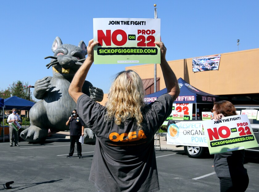 Advocates of voting no on Proposition 22 in the city of Orange