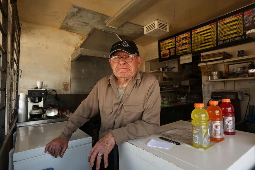 Bill Elwell of Bill's Burgers waits for customers to order takeout at his Van Nuys burger stand.