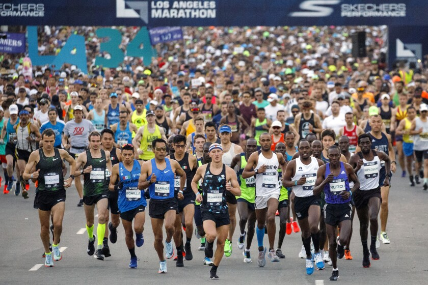 Elite runners at the start of the 2019 L.A. Marathon. Many training programs start in August for the annual race.