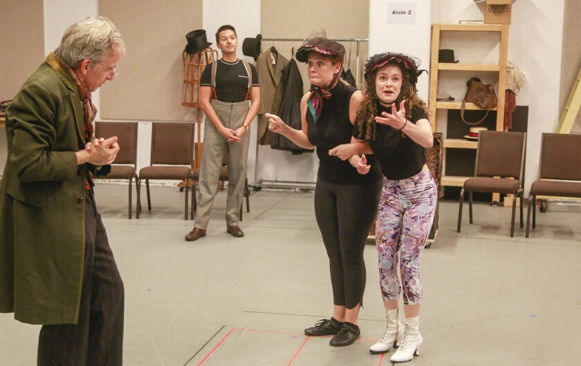 """Robert Joy, Dan Rosales, Jacque Wilke and Cathryn Wake (from left) rehearse a scene from """"Ebenezer Scrooge's BIG San Diego Christmas Show"""" at the Old Globe Theatre."""
