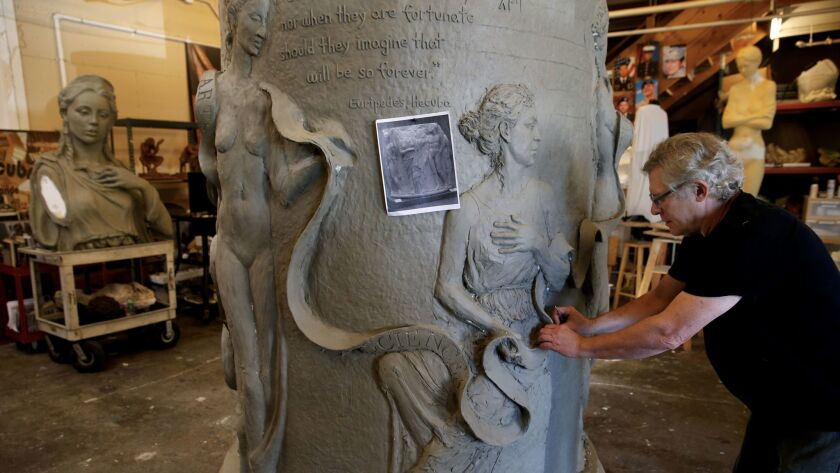 Christopher Slatoff works on the sculpture at his studio in Los Angeles.