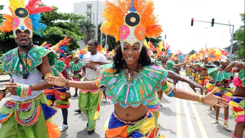 People dance in a procession during the yearly carnival in Lagos, Nigeria on April 9, 2012.