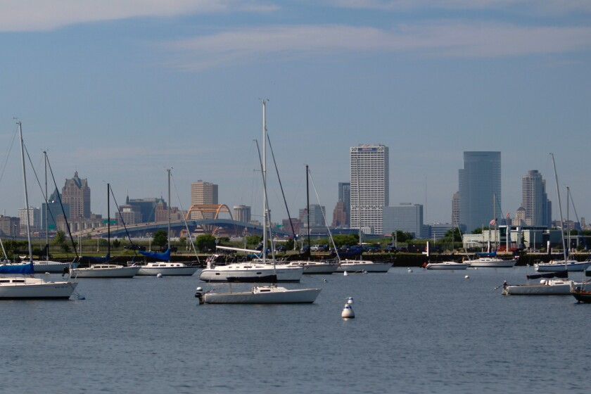 This Aug. 13, 2020 photo shows the skyline of downtown Milwaukee, the location of a scaled down Democratic National Convention. About 50,000 visitors were expect to inject about $250 million into the economy of the key presidential battleground state. But now, thanks to the ongoing coronavirus pandemic, the convention is nearly entirely online, with all of the major speakers, including presumptive nominee Joe Biden, skipping the trip to Milwaukee. It would have been the first time Milwaukee, a city of 1.6 million, hosted a presidential nominating convention. (AP Photo/Carrie Antlfinger)