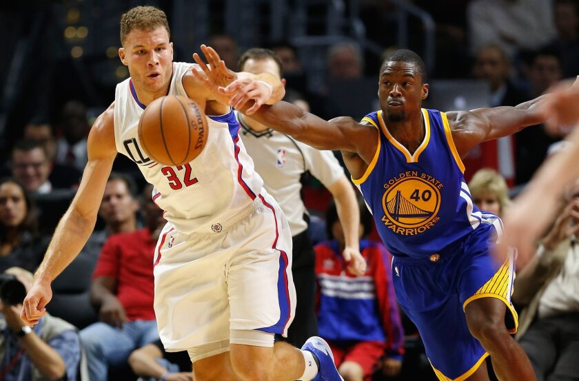 Blake Griffin battles for a loose ball with Golden State's Harrison Barnes on Thursday.