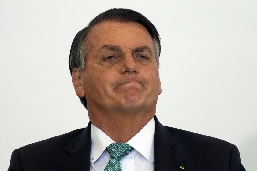 Brazilian President Jair Bolsonaro attends the launch ceremony for a housing program at Planalto presidential palace in Brasilia, Brazil, Wednesday, Sept. 15, 2021. (AP Photo/Eraldo Peres)