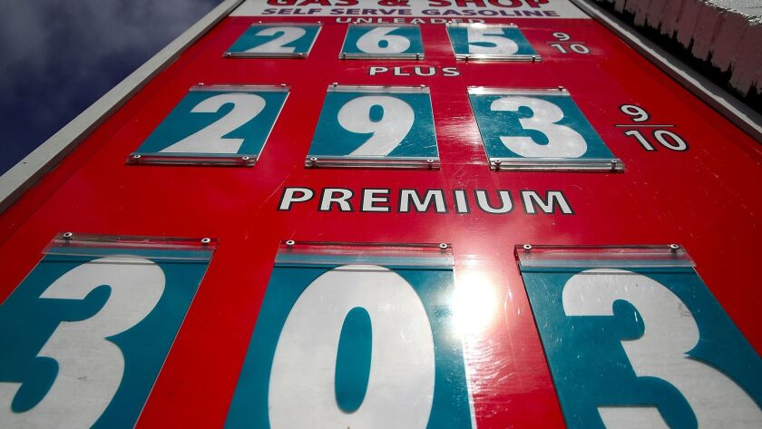 Prices are displayed at a San Anselmo gas station on May 10. The state's gas taxes will go up this year, and a ballot initiative has been filed for voters to consider scrapping the plan in 2018.