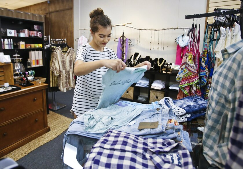 Nineteen-year-old Jessica Dupre began working at Wysh Boutique last summer, then picked up a second part-time job at the Gaia Gelaton ice cream store in Carlsbad Faire to make ends meet. She plans to attend Palomar College in the fall.