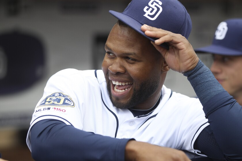 The Padres' Manuel Margot shares a laugh in the dugout before Tuesday's game against the Rockies at Petco Park.