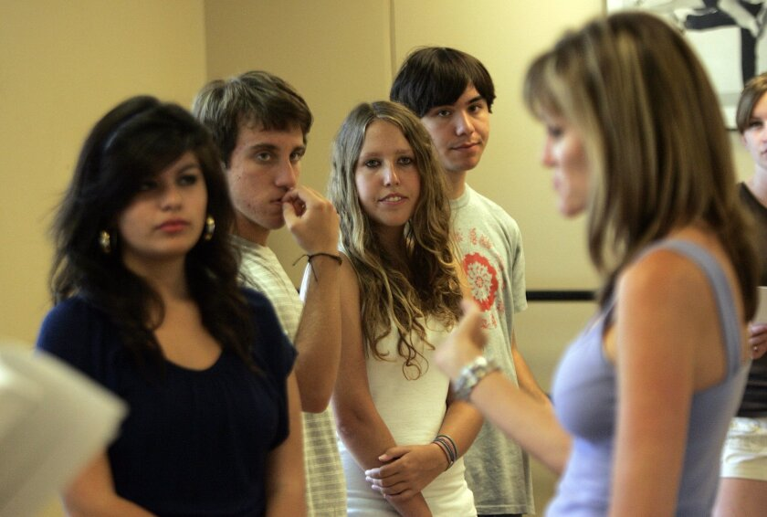 Sandy Redmon instructed (from left) Stephanie Orozco, Sean Fogarty, Kristen Smith and Jason Mullins. (John Gastaldo / Union-Tribune)