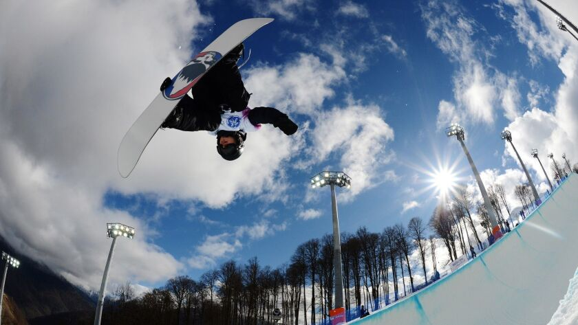 Russia's Dmitriy Koltsov competes at a halfpipe qualifying event for the Snowboard World Cup at the Snowboard and Freestyle Center in Sochi, Russia, in 2013.