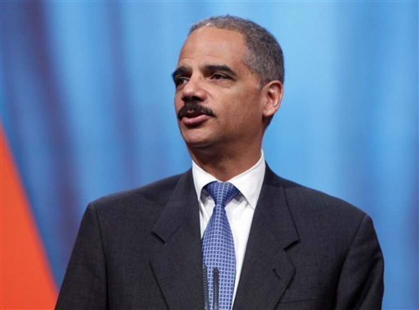 U.S. Attorney General Eric Holder addresses the International Association of Chiefs of Police Conference in Denver on Monday, Oct. 5, 2009.(AP Photo/Ed Andrieski)