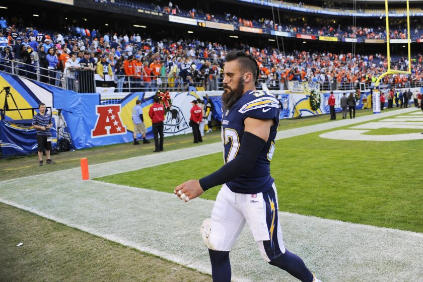 Chargers Eric Weddle walks of the field after a  22-10 loss to the Broncos.