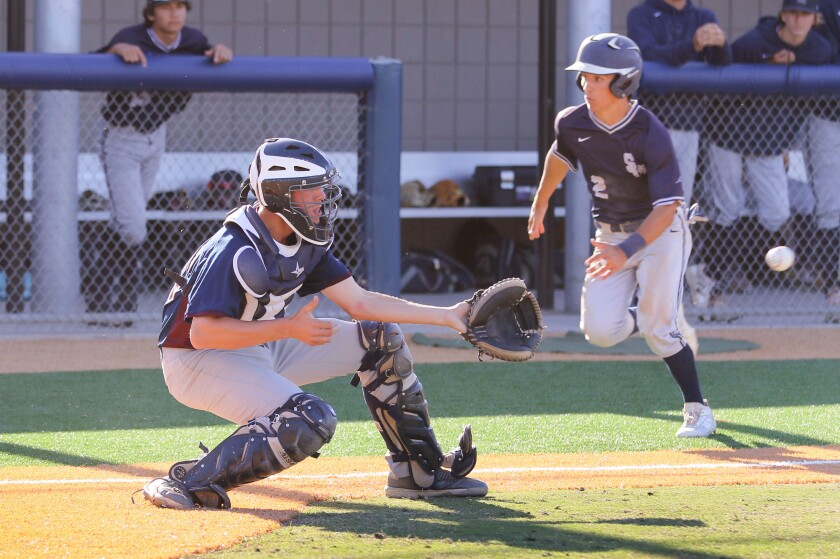 Luca Fernandez, of San Marcos is about to score, driven in by teammate Kyle Carr's two run double. Scripps Ranch catcher Ethan Babcock-Barrie waits for the late throw.