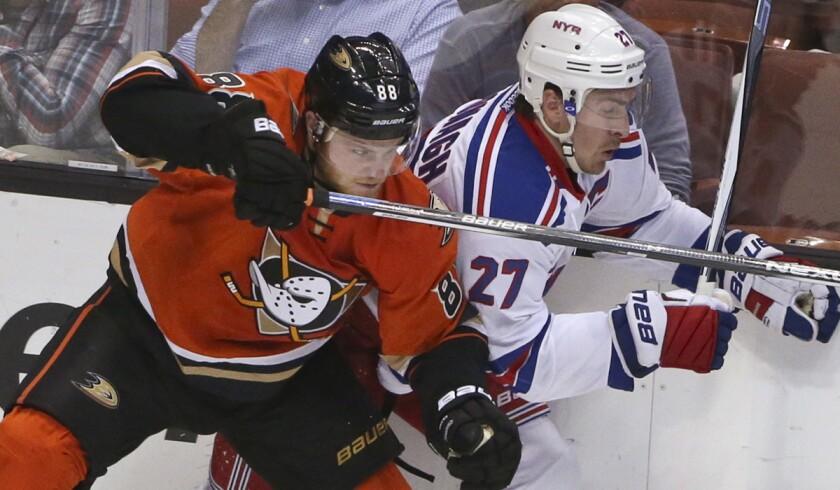 Anaheim Ducks left wing Jamie McGinn slams a check into New York Rangers defenseman Ryan McDonagh during the second period on Wednesday.