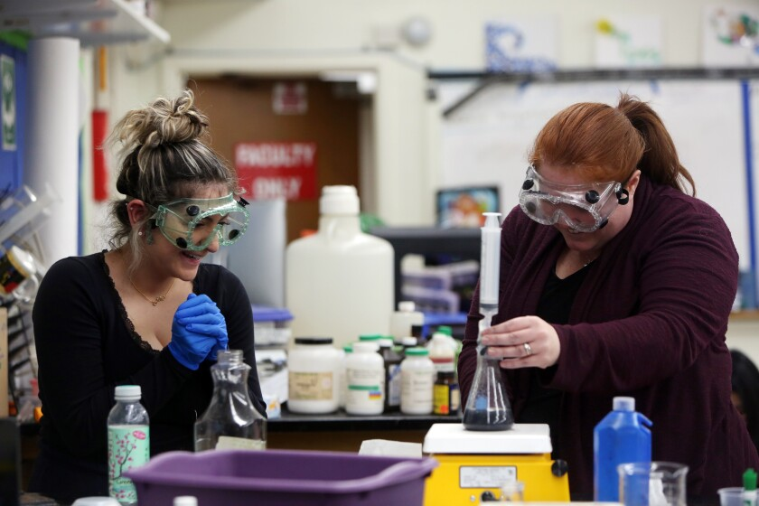 Science teacher Jeanette Chipps, right, who also trains educators on the state's new science standards, works with a student at Granada Hills Charter High School in December.
