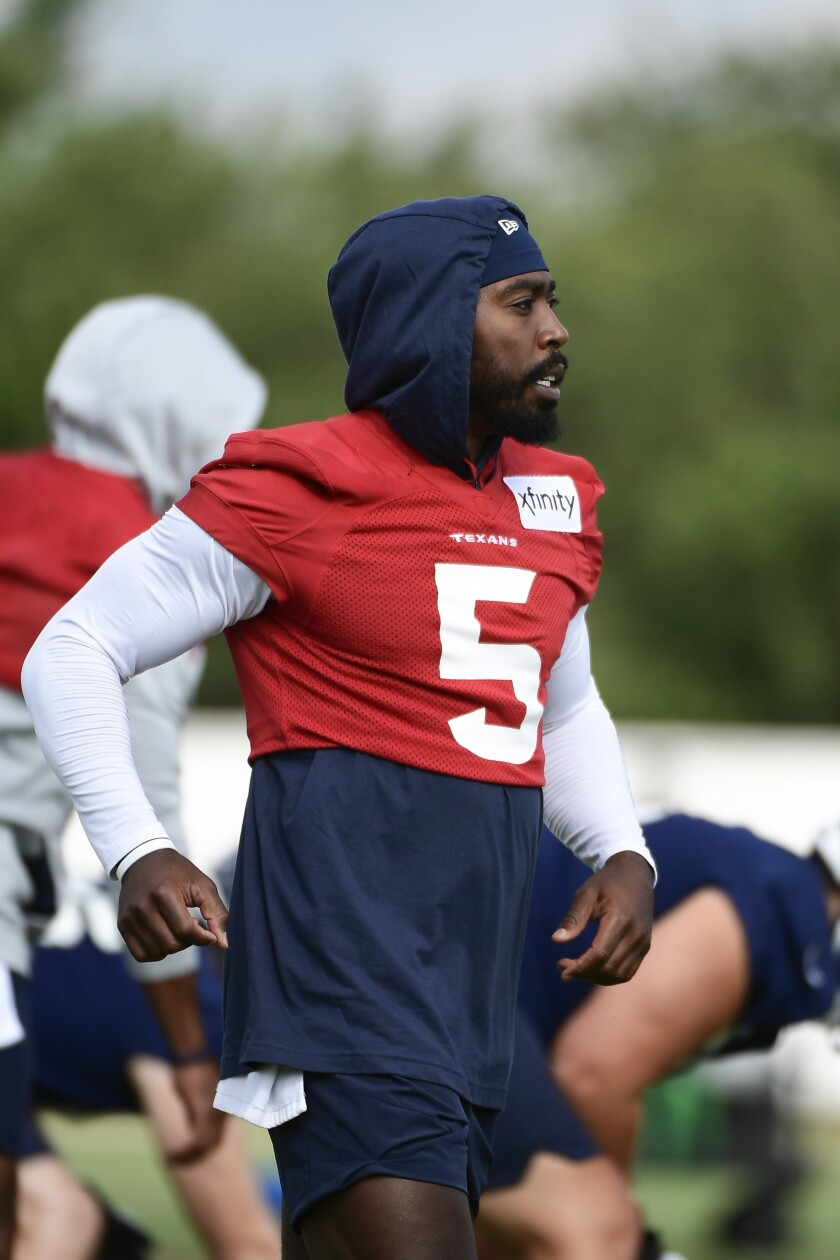 Texans quarterback Tyrod Taylor (5) works out with the team during NFL football practice Thursday, July 29, 2021, in Houston. (AP Photo/Justin Rex)