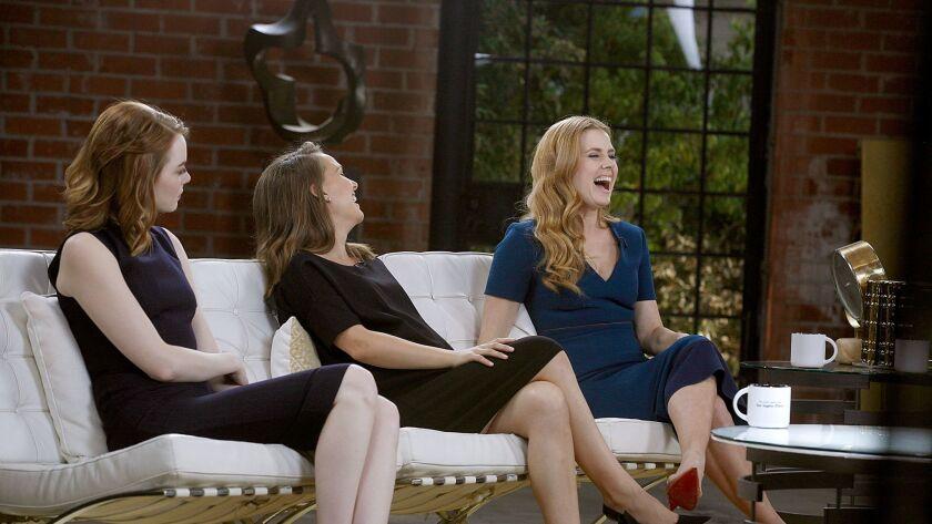 Actresses Emma Stone, Natalie Portman and Amy Adams enjoy a laugh at the Envelope panel.