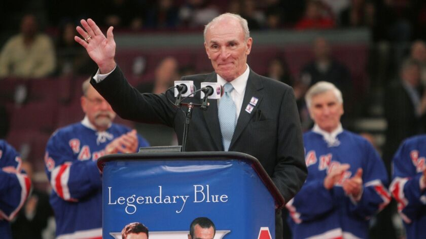 Harry Howell waves to the crowd during a ceremony to retire his number before a New York Rangers game on Feb. 22, 2009, at Madison Square Garden in New York.