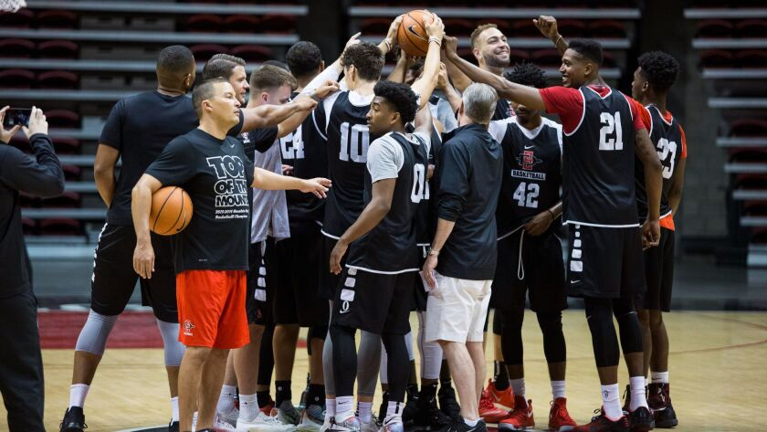 The SDSU basketball cheers at the start of their first team practice for 2017-2018.