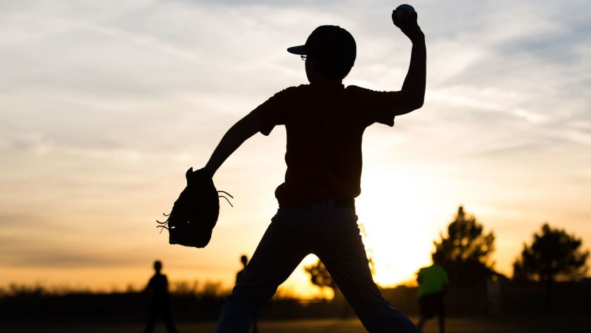 Kaiden Wells, 10, throws a baseball during Odessa Rage Youth baseball team practice Wednesday, Jan.