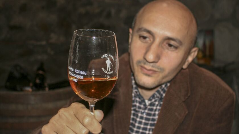 Republic of Georgia - Irakli Rostomashvili admires one of the wines in his private winery, establish