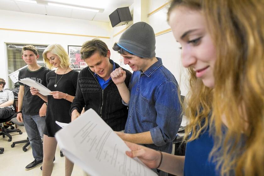 Huntington Beach High School students Max Kozik, left, Holly Schow, Skylar Davis, James Hammil and Eden Hawes run through lines of a short film on Feb. 26.