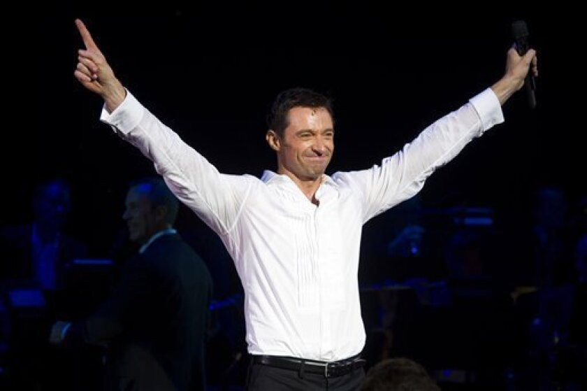 """FILE- In this Thursday, Nov. 10, 2011 file photo, Hugh Jackman appears onstage at the curtain call for the opening night performance of """"Hugh Jackman, Back on Broadway"""", in New York. Jackman has left a lot of broken hearts and records on Broadway. (AP Photo/Charles Sykes, File)"""