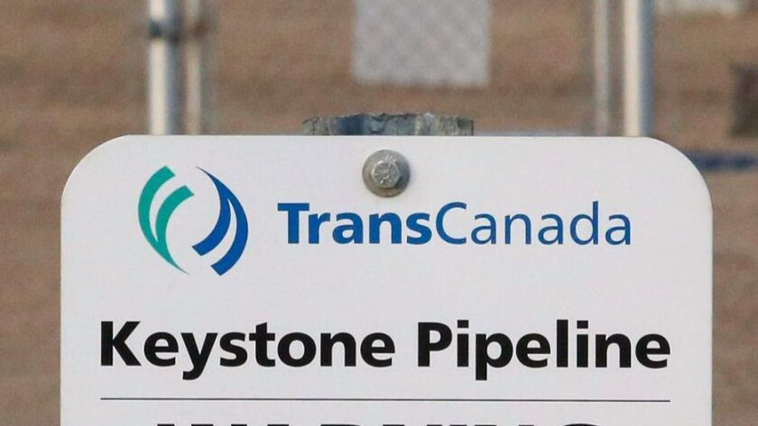 FILE- This Nov. 6, 2015, file photo shows a sign for TransCanada's Keystone pipeline facilities in H