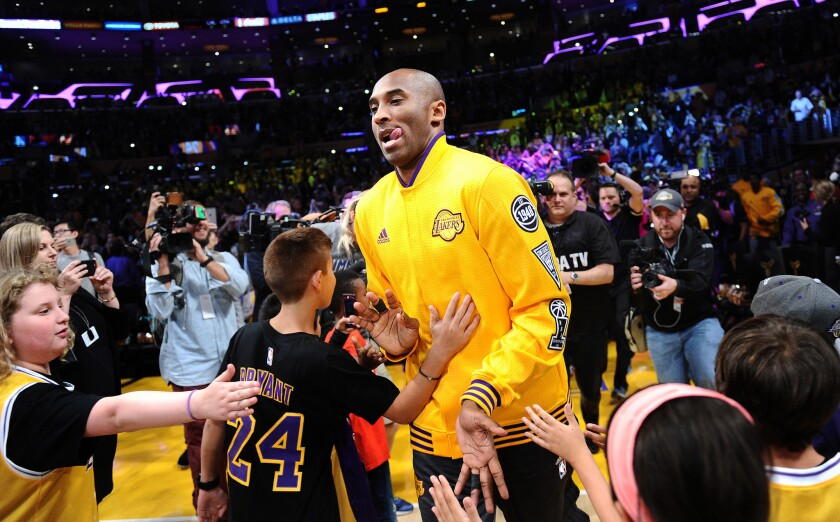 Kobe Bryant is welcomed onto the court for his farewell game at Staples Center on April 13.