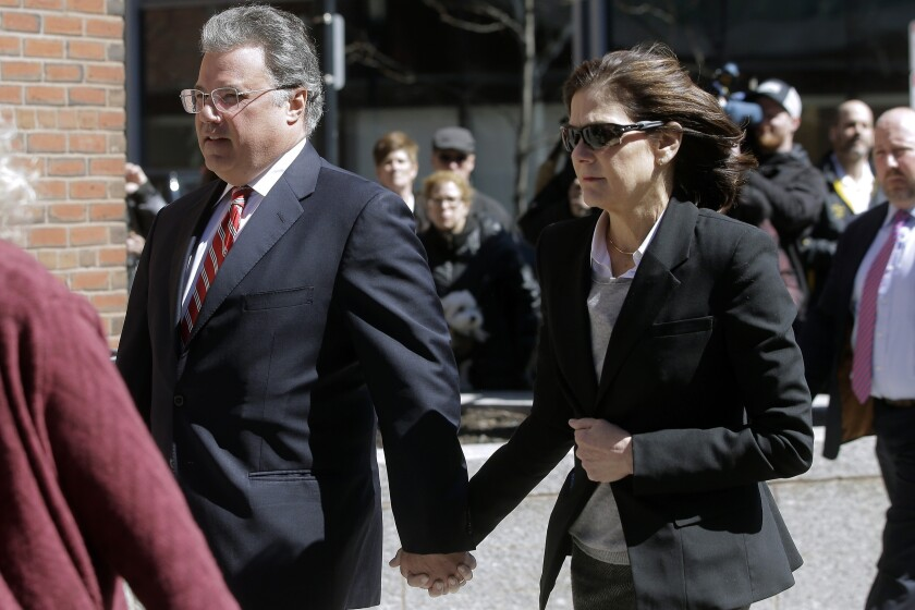 Manuel and Elizabeth Henriquez arrive at federal court in Boston to face charges in college admissions bribery scandal.