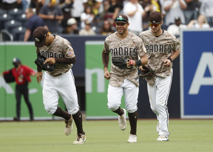 Trent Grisham, Tommy Pham and Wil Myers run off the field after a victory this season.