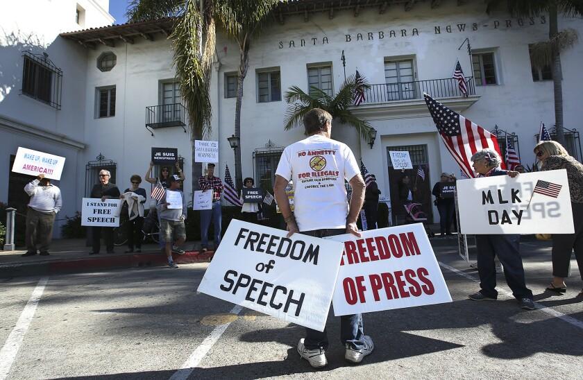 Protesting outside the Santa Barbara News Press
