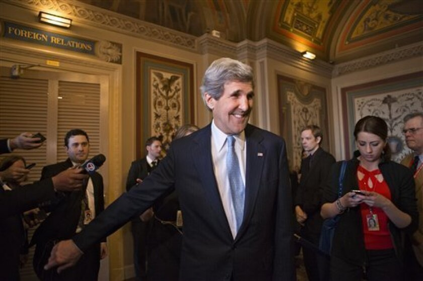 Sen. John Kerry, D-Mass., emerges after a unanimous vote by the Senate Foreign Relations Committee approving him to become America's next top diplomat, replacing Secretary of State Hillary Rodham Clinton, on Capitol Hill in Washington, Tuesday, Jan. 29, 2013. Kerry, who has served on the Foreign Re