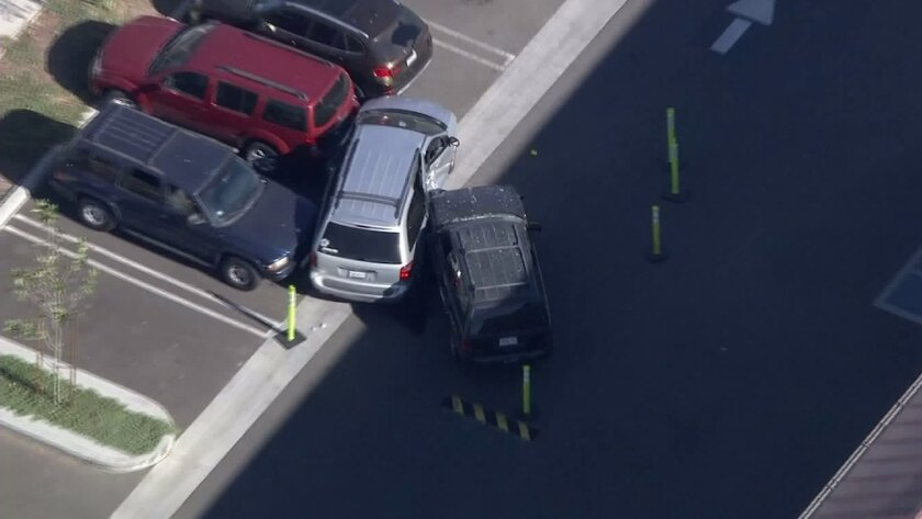 Five students and a 19-year-old woman suffered minor injuries after they were struck by a car in a school parking lot in Sylmar.