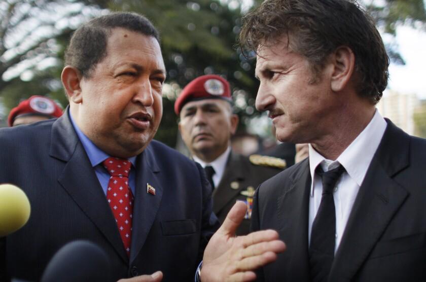 Late Venezuelan president Hugo Chavez, left, talks to actor Sean Penn at the presidential palace in Caracas, Venezuela on Feb. 16, 2012.