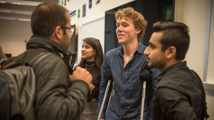 UC Berkeley student Tyler Heintz, center, speaks with students in a class that tries to find technological solutions to combat international terrorism.
