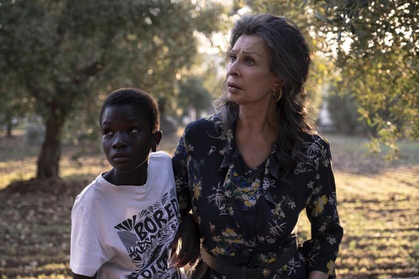 "Ibrahima Gueye and Sophia Loren in the movie ""The Life Ahead."""