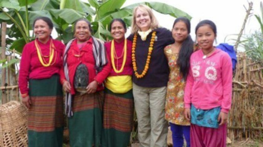Marsha Wallace, DFW's founder, meets Nepalese women, who are receiving obstetrics care, thanks to Dining For Women's support. Nepal is just one of 36 countries where the organization has changed women and girls' lives. Courtesy of Dining for Women