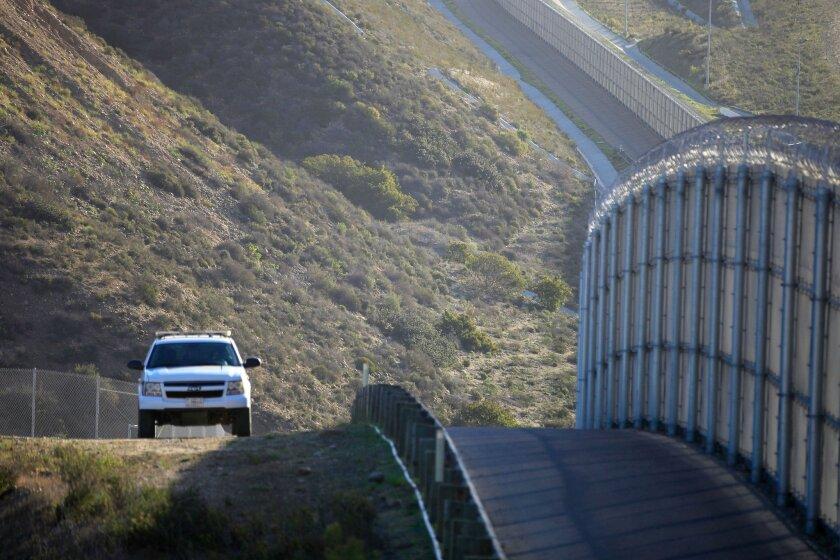 A Border Patrol vehicle patrols near Border Field State Park.