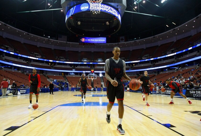 San Diego State's Malcolm Thomas warms up during practice at the Honda Center in Anaheim on March 23.