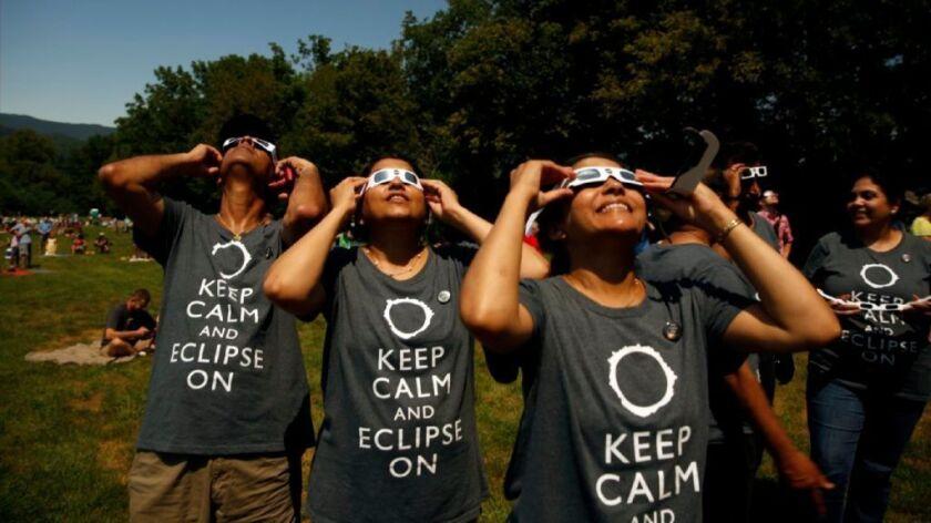 Spectators took in the solar eclipse Monday in Heritage Park in Andrews, N.C.