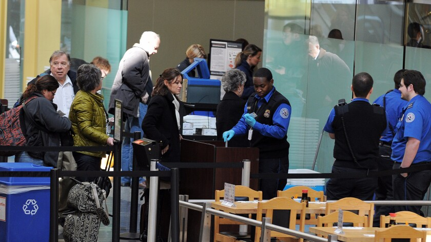 Transportation Security Administration (TSA) personnel work at the Ronald R
