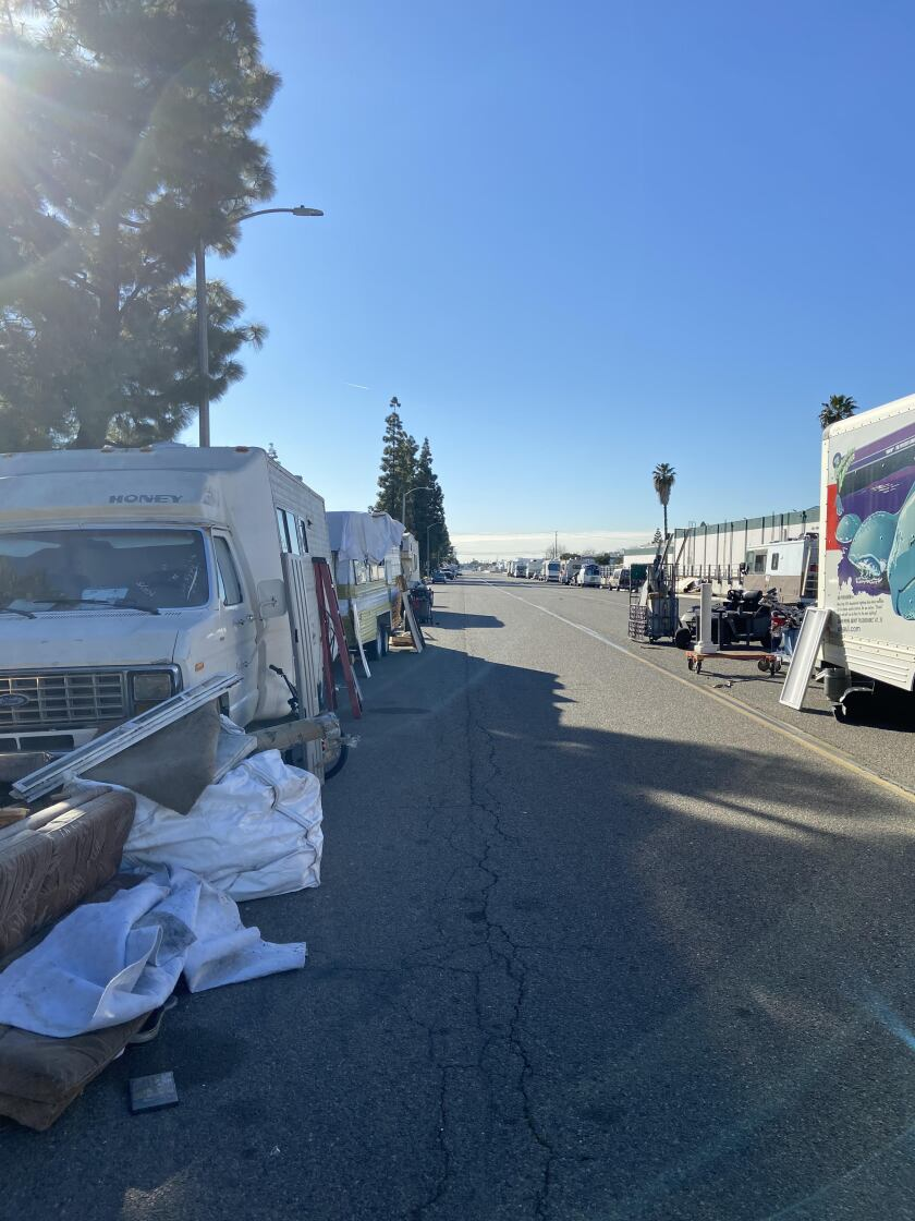 Several RVs are parked on Valencia Drive in Fullerton, where the city will begin enforcing parking restrictions.