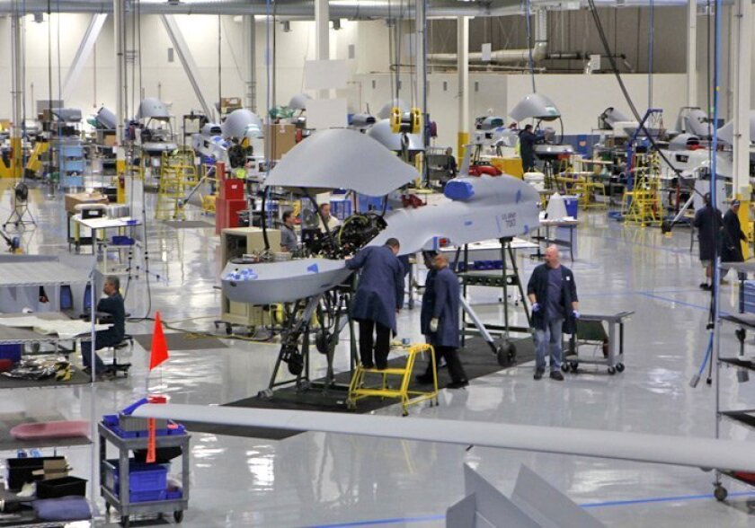 Technicians at Poway-based General Atomics Aeronautical Systems worked on the fuselage of a Sky Warrior drone at the factory Thursday. The company's unmanned-aerial-vehicle program includes the Sky Warrior, the Predator and the Predator B.