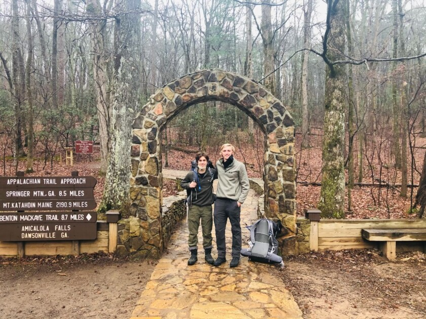 Sammy Potter, 21, and Jackson Parell, 20, stand at the trailhead of the Appalachian Trail in Georgia.