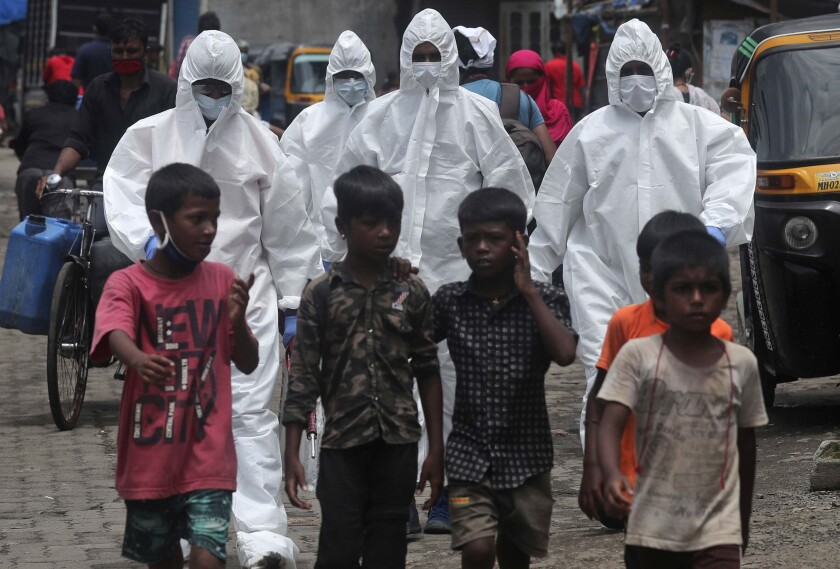 Health workers arrive to screen people for COVID-19 symptoms at a slum in Mumbai, India, Friday, July 10, 2020. India has overtaken Russia to become the third worst-affected nation by the coronavirus pandemic. (AP Photo/Rafiq Maqbool)